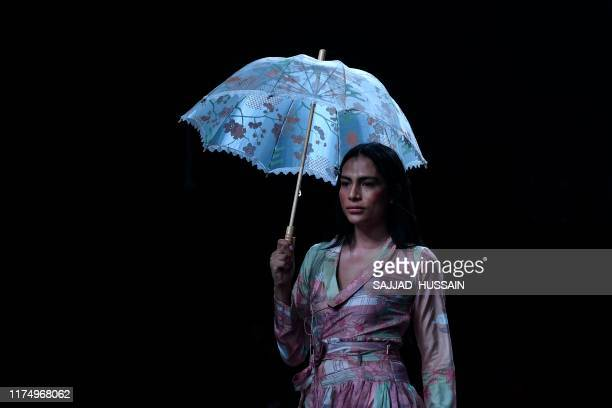 A model presents a creation by designer Shruti Sancheti during a fashion show at Lotus Makeup India Fashion Week in association with EbixCash Spring...