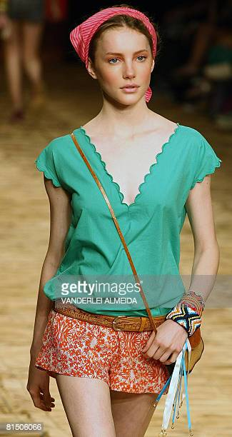 A model presents a creation by designer Teca during the Rio Fashion Week SpringSummer 200809 collection at the Marina da Gloria on June 9 2008 in Rio...