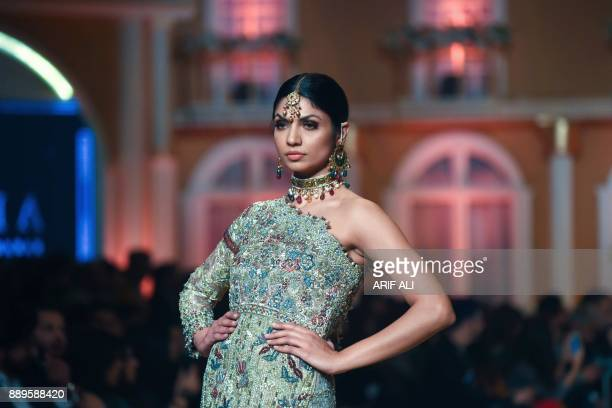 Model presents a creation by designer Umsha by Uzma Babar on the last day of the Pantene Hum Bridal Couture Week in Lahore on December 10, 2017. /...