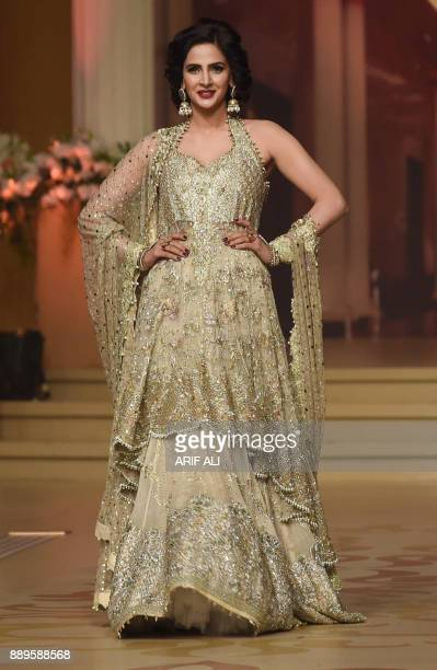 A model presents a creation by designer Umsha by Uzma Babar on the last day of the Pantene Hum Bridal Couture Week in Lahore on December 10 2017 /...