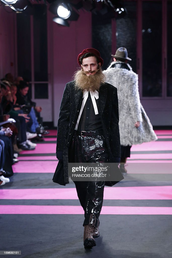 A model presents a creation by designer Yohji Yamamoto during the men's Fall-Winter 2013-2014 collection show on January 17, 2013 as part of the Men's fashion week in Paris.