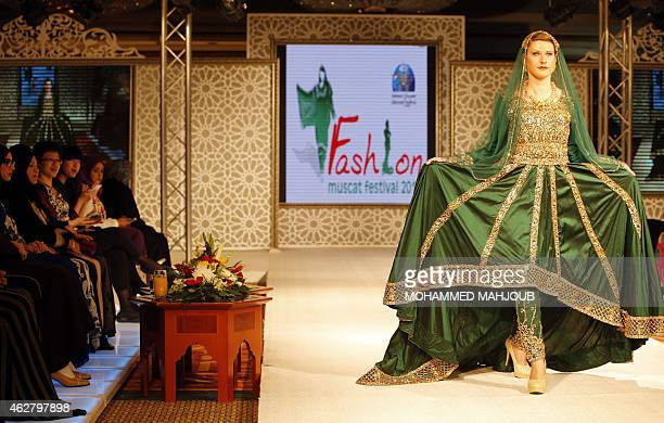 A model presents a creation by designer Zakiah alMouwahiya during a fashion show organised as part ot the Muscat Festival on February 5 2015 in the...