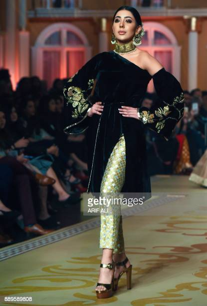 A model presents a creation by designer Zonia Anwaar on the last day of the Pantene Hum Bridal Couture Week in Lahore on December 10 2017 / AFP PHOTO...