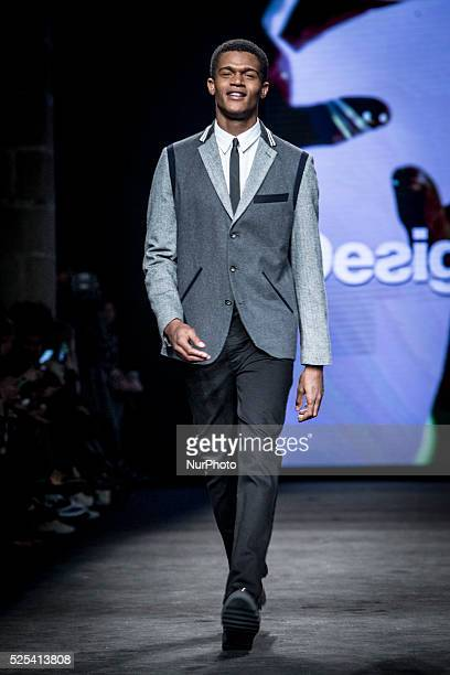 A model presents a creation by Desigual at the 080 Barcelona Fashion Week 2015 on February 3 2015 in Barcelona Spain