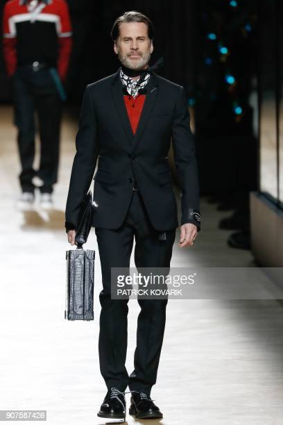 A model presents a creation by Dior during the men's Fashion Week for the Fall/Winter 2018/2019 collection in Paris on January 20 2018 / AFP PHOTO /...