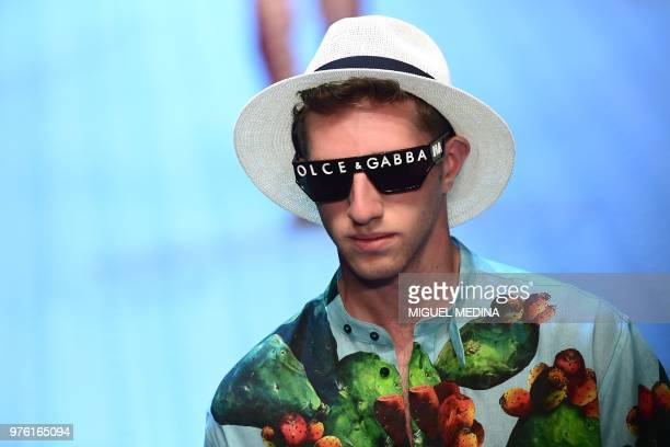 A model presents a creation by Dolce Gabbana during the men women's spring/summer 2019 collection fashion show in Milan on June 16 2018