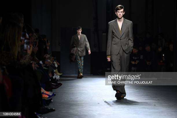 Model presents a creation by Dries Van Noten during men's Fashion Week for the Fall/Winter 2019/2020 collection in Paris on January 17, 2019.