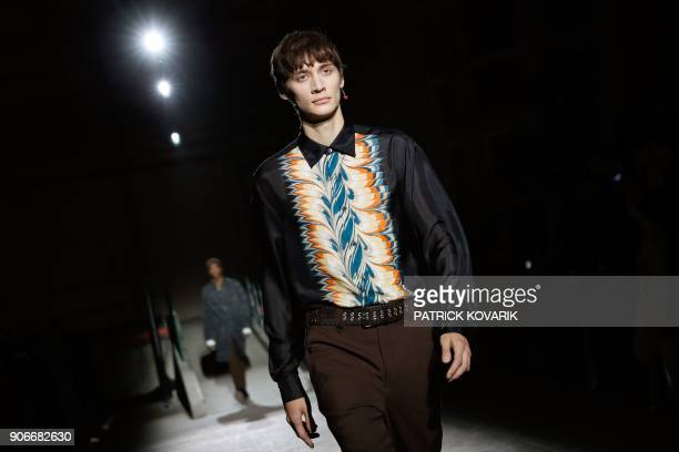 A model presents a creation by Dries Van Noten during the men's Fashion Week for the Fall/Winter 2018/2019 collection in Paris on January 18 2018 /...