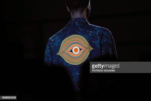 TOPSHOT A model presents a creation by Dries Van Noten during the men's Fashion Week for the Fall/Winter 2018/2019 collection in Paris on January 18...