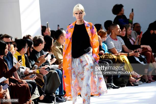 A model presents a creation by Dries Van Noten during the SpringSummer 2019 ReadytoWear collection fashion show in Paris on September 26 2018