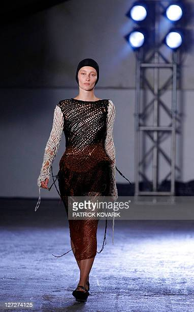 A model presents a creation by Dutch designer Josephus Thimister during the Spring/Summer 2012 readytowear collection show on September 27 2011 in...