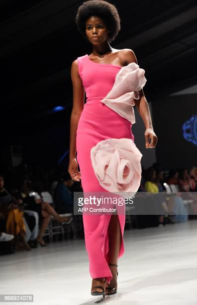 Model presents a creation by Dzyn during the Lagos Fashion and Design Week in Lagos, on October 26, 2017. The yearly Lagos Fashion and Design Week is...