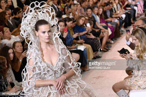 A model presents a creation by Elie Saab during the 20182019 Fall/Winter Haute Couture collection fashion show in Paris on July 4 2018