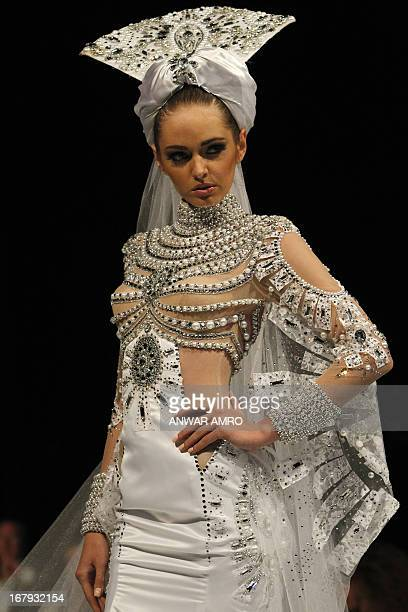 A model presents a creation by Emirati designer Mona alMansouri during a fashion show in Beirut on May 2 2013 AFP PHOTO/ANWAR AMRO