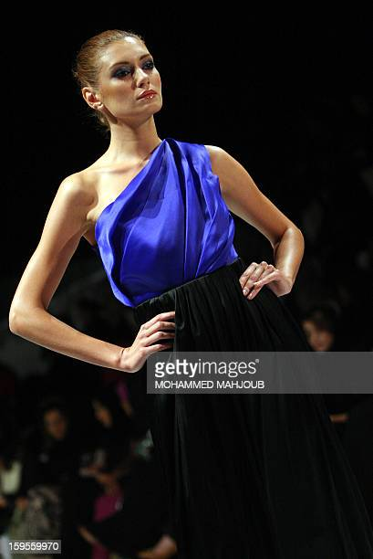 A model presents a creation by Emirati fashion house Das Collection during the 2013 Muscat Fashion Week in the Omani capital late on January 15 2013...