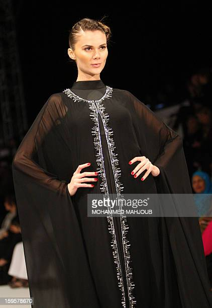 A model presents a creation by Emirati fashion house Kanzi during the 2013 Muscat Fashion Week in the Omani capital late on January 16 2013 AFP PHOTO...