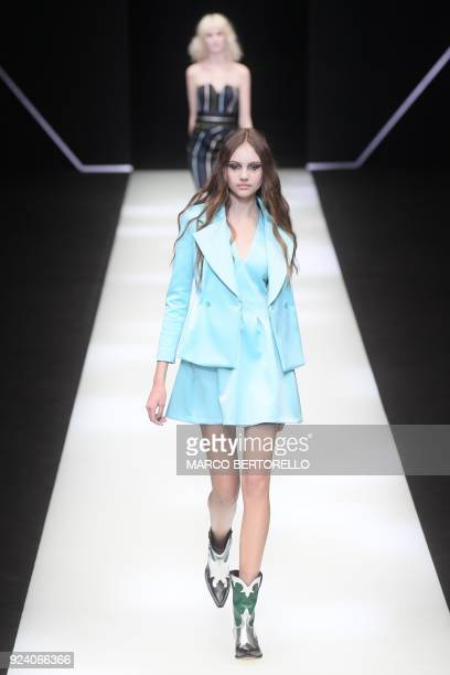 A model presents a creation by Emporio Armani during the women's Fall/Winter 2018/2019 collection fashion show in Milan on February 25 2018 / AFP...