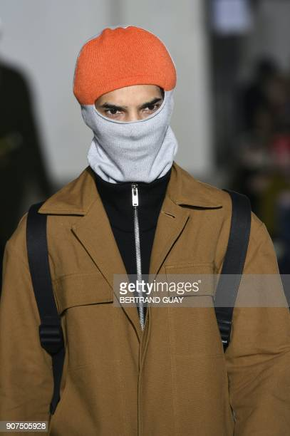A model presents a creation by Etudes during men's Fashion Week for the Fall/Winter 2018/2019 collection in Paris on Janaury 20 2018 GUAY