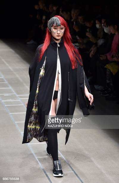 A model presents a creation by fashion brand Acuod by Chanu for their 2018 autumn/winter collection at Tokyo Fashion Week in Tokyo on March 23 2018 /...