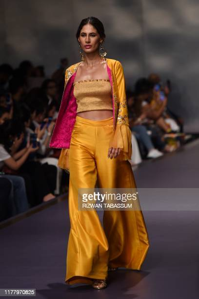 Model presents a creation by Fashion brand The Pink Tree on the second day of the Fashion Pakistan Week Winter Festive 2019 in Karachi on October 24,...