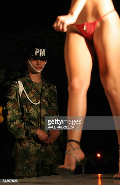 A model presents a creation by fashion designer Adriana Arango Colombia's brand Besame at the fourth brigade of Colombian Army on June 13 2008 in...