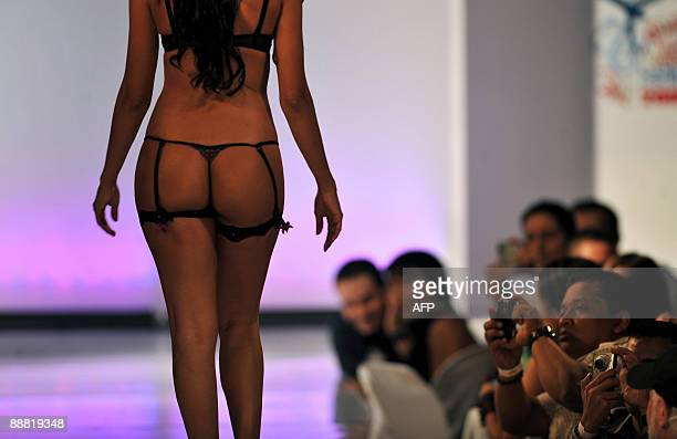 A model presents a creation by fashion designer Adriana Arango for Colombia's brand Besame during Angeles Summer Fashion 2009 on July 3 2009 in Cali...