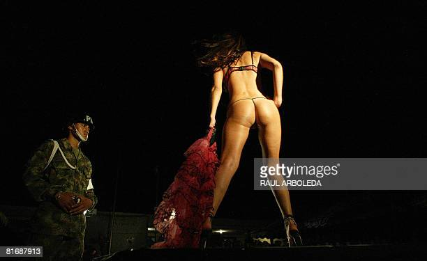 A model presents a creation by fashion designer Adriana Arango of Colombia's brand Besame at the fourth brigade of Colombian Army on June 13 2008 in...