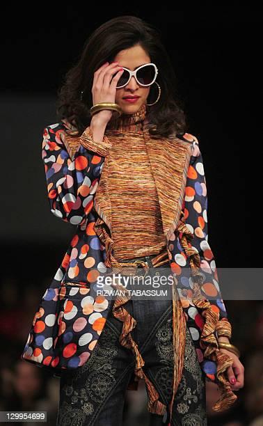 A model presents a creation by fashion designer Ammar Belal during PFDC Sunsilk Fashion Week in Karachi on October 22 2011 AFP PHOTO / RIZWAN TABASSUM