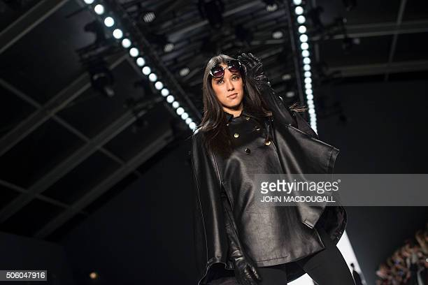 Model presents a creation by fashion designer Dimitri at the Berlin Fashion week on January 21, 2016. The Berlin Fashion Week is running from January...