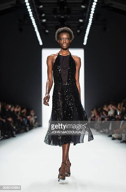 Model presents a creation by fashion designer Dimitri Panagiotopoulos aka Dimitri at the Berlin Fashion week on January 21, 2016. / AFP / John...