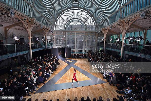 A model presents a creation by fashion designer Nicole Farhi during her show at the Royal Opera House in London on the fifth day of London Fashion...