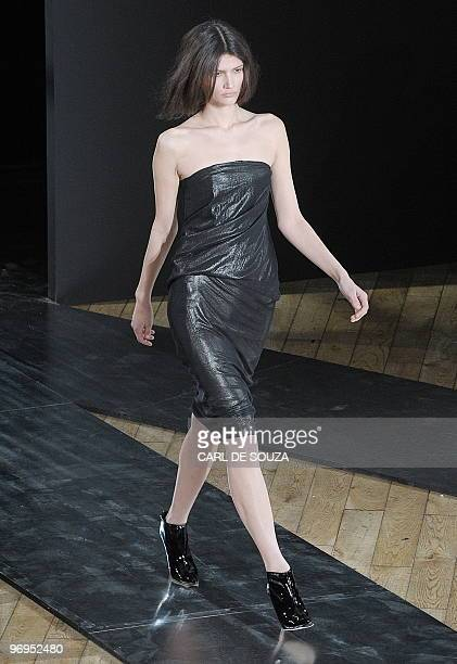 A model presents a creation by fashion designer Nicole Farhi during her show at the Royal Opera House London during the fifth day of London Fashion...