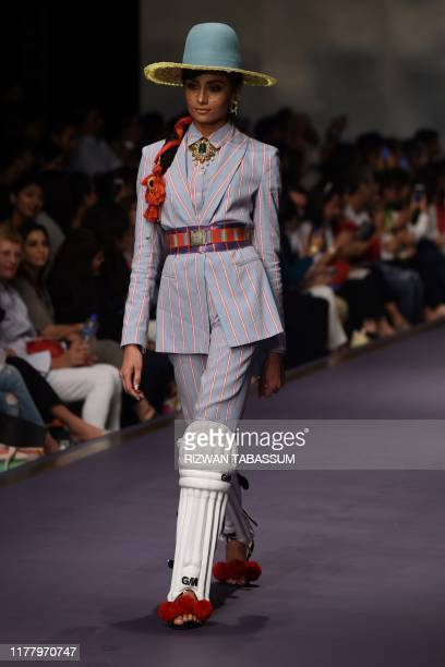 A model presents a creation by fashion designer Stella Jean Roma on the second day of the Fashion Pakistan Week Winter Festive 2019 in Karachi on...