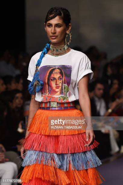 Model presents a creation by fashion designer Stella Jean Roma on the second day of the Fashion Pakistan Week Winter Festive 2019 in Karachi, on...