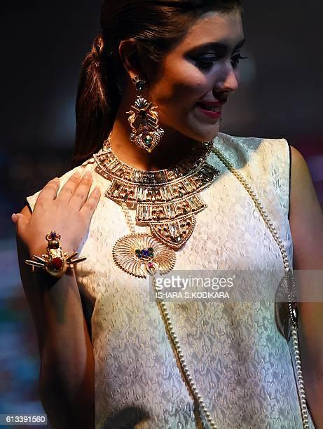 A model presents a creation by fashion designer Valliyan at Lakme fashion show event in Colombo on October 8 2016 / AFP / ISHARA SKODIKARA