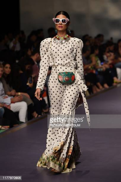 Model presents a creation by Fashion designer Zellburry on the second day of the Fashion Pakistan Week Winter Festive 2019 in Karachi on October 24,...