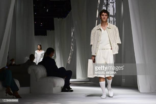 Model presents a creation by Fendi's Spring/Summer 2021 women's and mens collection during the Milan Fashion Week, on September 23, 2020.