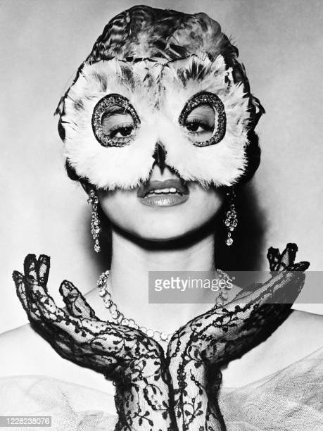 Model presents a creation by Fernand Aubry, a mask for the Paris ball season, on October 5 in Paris.