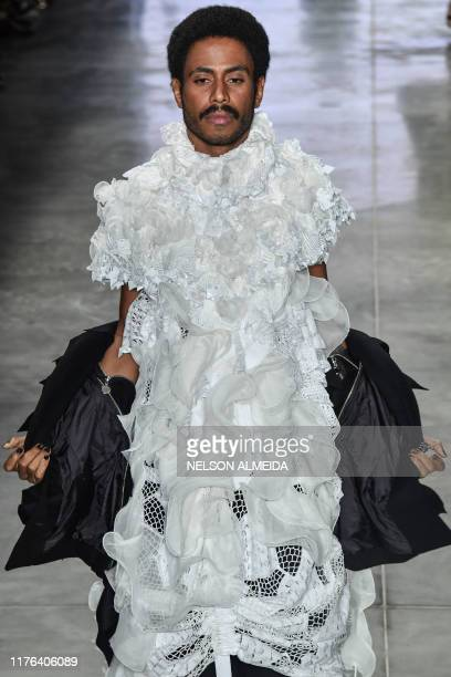 A model presents a creation by Fernanda Yamamoto during the Sao Paulo Fashion Week in Sao Paulo Brazil on October 17 2019