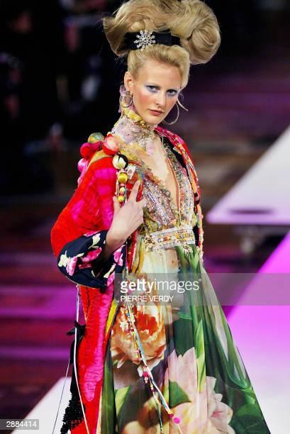 A model presents a creation by French designer Christian Lacroix as part of the Spring/Summer 2004 Haute Couture week in Paris 20 January 2004 AFP...