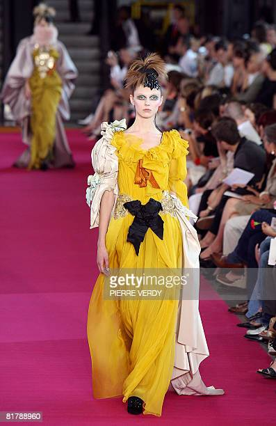 Model presents a creation by French designer Christian Lacroix during Fall-Winter 2009 Haute Couture collection show at at Centre Georges Pompidou in...