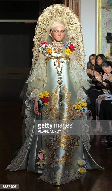 A model presents a creation by French designer Christian Lacroix during 2009/2010 AutumnWinter Haute Couture collection show on July 7 in Paris AFP...