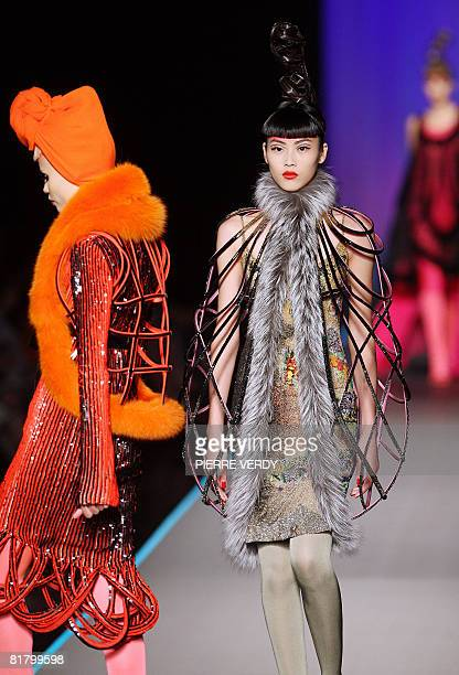 Model presents a creation by French designer Jean-Paul Gaultier during Fall-Winter 2009 Haute Couture collection show in Paris on July 2, 2008. AFP...