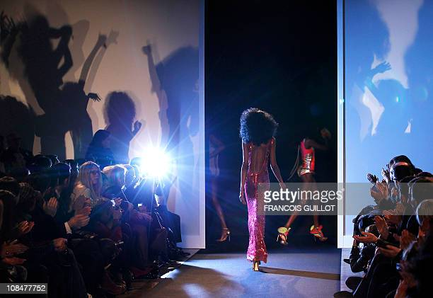Model presents a creation by French designer Julien Fournie during the Spring-Summer 2011 Haute Couture Collection Show on January 25 in Paris. AFP...