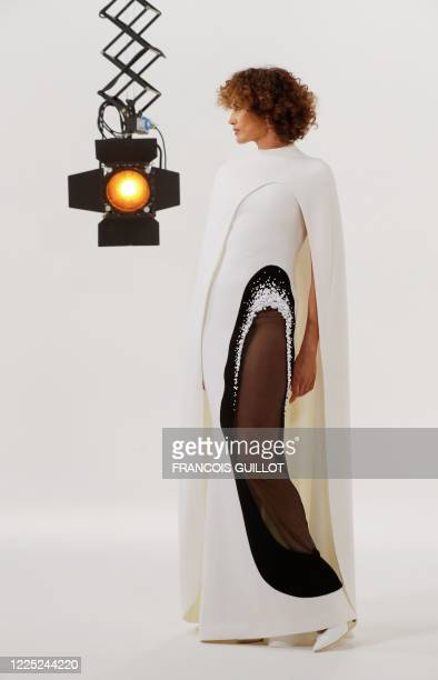 A model presents a creation by French designer Stephane Rolland during the shooting of a film designed to replace Haute Couture fashion shows in...