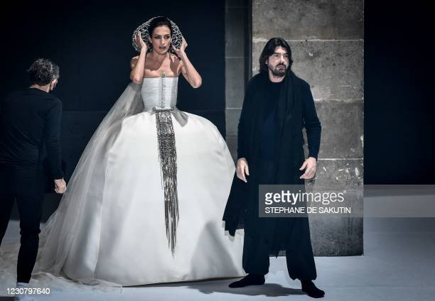 Model presents a creation by French designer Stephane Rolland during the shooting of a film designed to replace Haute Couture fashion shows in Paris...