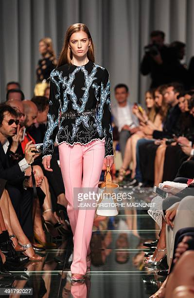 A model presents a creation by French fashion house Louis Vuitton during the collection show entitled 'Croisiere' on May 17 in Monaco AFP PHOTO /...