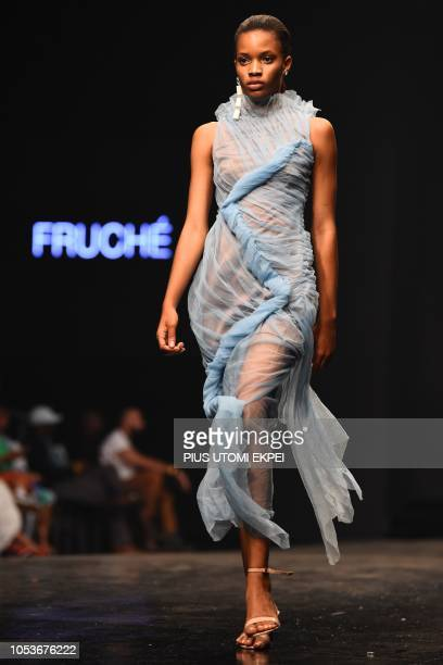 Model presents a creation by Fruche during the Lagos Fashion Week on October 25, 2018. - Lagos Fashion Week aims to promote the Nigerian, African...
