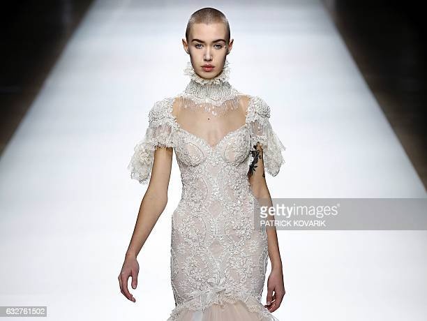 TOPSHOT A model presents a creation by Galia Lahav during the 2017 spring/summer Haute Couture collection on January 26 2017 in Paris / AFP / Patrick...