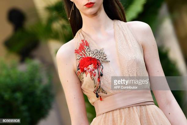 A model presents a creation by Galia Lahav during the 20172018 fall/winter Haute Couture collection in Paris on July 2 2017 / AFP PHOTO / bertrand...
